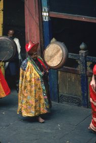 Monks: musician playing the drum, Paro Tshechu (tshe bcu).