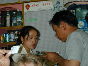 Ngawang (left), owner of a Chinese restaurant in Lhasa Gongkar Airport, and restaurant customer.