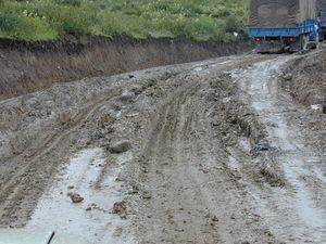 Muddied dirt road.