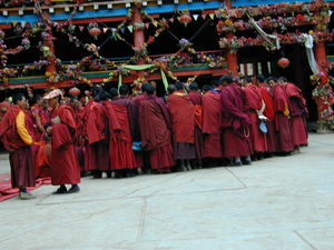 Tibetan monks watching a formal debtate of religious topics. (Larung Gar, China)