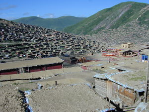 A view looking down Larung Valley with the Larung Gar Nunnery's new Assembly Hall under construction to the right.