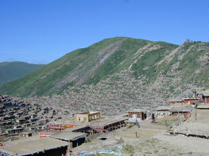 A view of the hillside containing the Nunnery at Larung Gar [bla rung gar] with its new Assembly Hall under construction in the foreground.