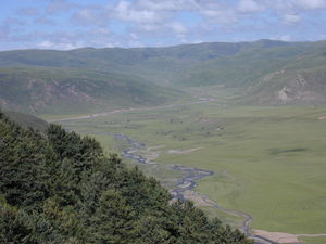 The river valley and nomad tents on the other side of hill where the Larung Gar [bla rung gar] Nunnery is located.
