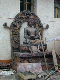 A Buddha statue under construction.