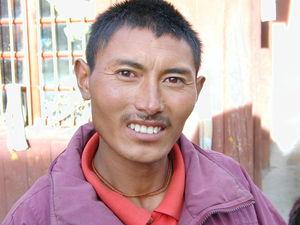 The orphanage gatekeeper. (Lhagang, China)