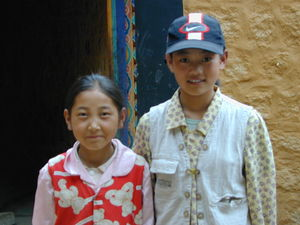 Two young Tibetan girls visiting the nunnery.