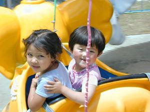 Young Tibetan girls on an amusement park ride.
