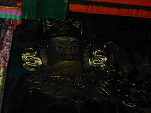 Close-up of the face of the large statue of Padmasambhava.