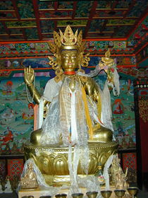 A statue of Avalokitesvara adorned with silk scarves on the second floor of the Zangdok Pelri Temple.