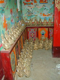 Statues of Padmasambhava along the wall on the second floor of the Zangdok Pelri Temple.