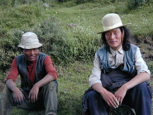 Two nomad men taking a break along the side of the road.