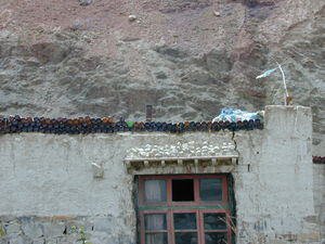 A roadside restaurant decorated with empty beer bottles.
