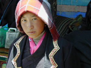 A young Tibetan woman visiting to watch the religious dance.