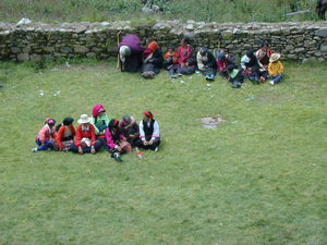 Tibetans waiting for the religious dances to begin.