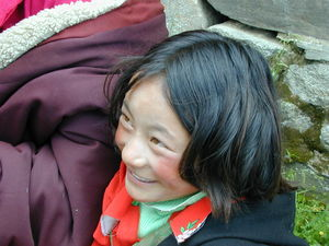 A close up of a young girl seated in the audience.