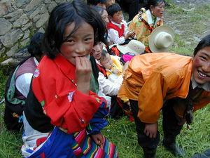 Tibetan children in the audience.