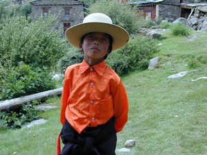 A young nomad boy on the path to the courtyard.