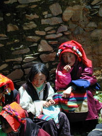 Two young girls watching the dances.
