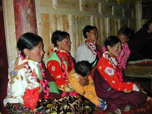 Nomad women and children waiting to see Abbot Dorji Tashi inside the monastery.