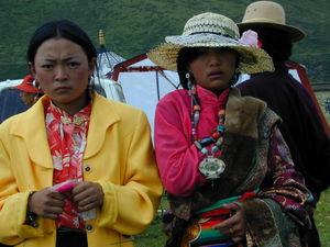 Dressed up young Tibetan women at the festival site.