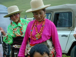 Two Tibetan women wearing multiple necklaces.