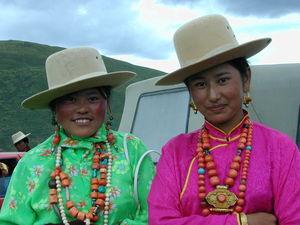 Tibetan women wearing large necklaces.