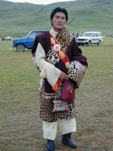A dressed up Tibetan singer.