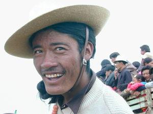 A close up of a Tibetan man laughing.