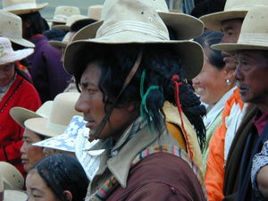 A nomad watching a performance.