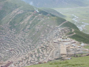 A view of Larung Gar, with the Gyutrul Temple in the foreground, from the top of Jomo Hill.