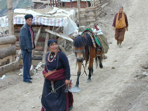 A nomad couple carrying meat to sell.