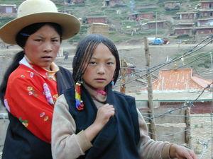 Nomad girls walking along the street.