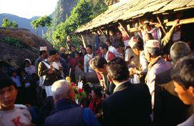 Men dancing round the 'plah' 'pae lava' including Prem