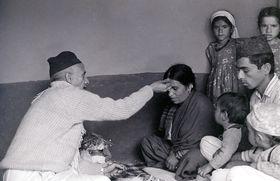 Household head gives Dasain tika to family members