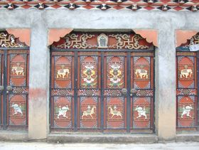 Intricately-decorated doors on building in Lhagang.