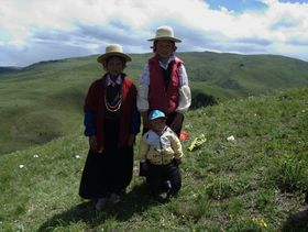 Tibetan nomad family on hill near Lhagang town.