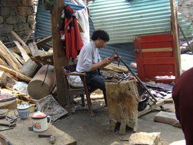 Artisan working at Lhagang Monastery