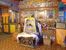 Ceremonial throne in front of lineage members at Lhagang Monastery