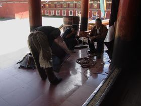 Tibetan workmen constructing a statue at Lhagang Monastery