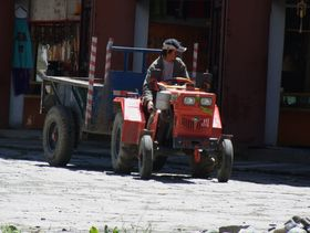 Farm worker in Lhagang town.