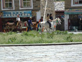 Nomads on horses in Lhagang town