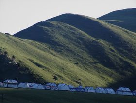 White nomadic tents near Lhagang town.