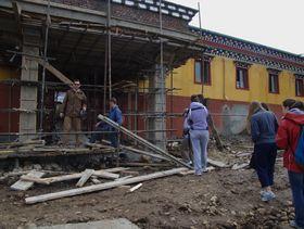 Westerners visiting Dora Gamo school.
