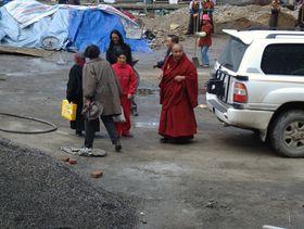 Monk examining new construction at Dora Garmo.
