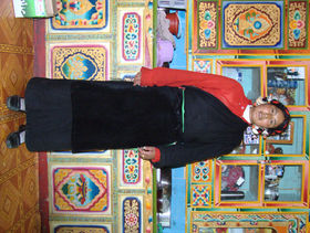 Hotel worker in Lhagang tea house.