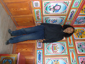 Hotel worker in Lhagang.