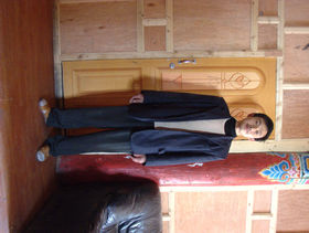 Worker at hotel in Lhagang.