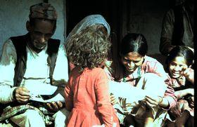 Jaisi Bahun family examines photos taken 23 yrs before