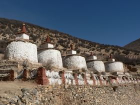 Row of stupas, called &ldquo;Auspicious Stupas&rdquo; (<em>bkra shis mchod rten</em>), at Lo Monastery.