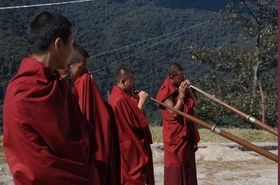 The monk blowing trumpet during Chhukha Tsechu